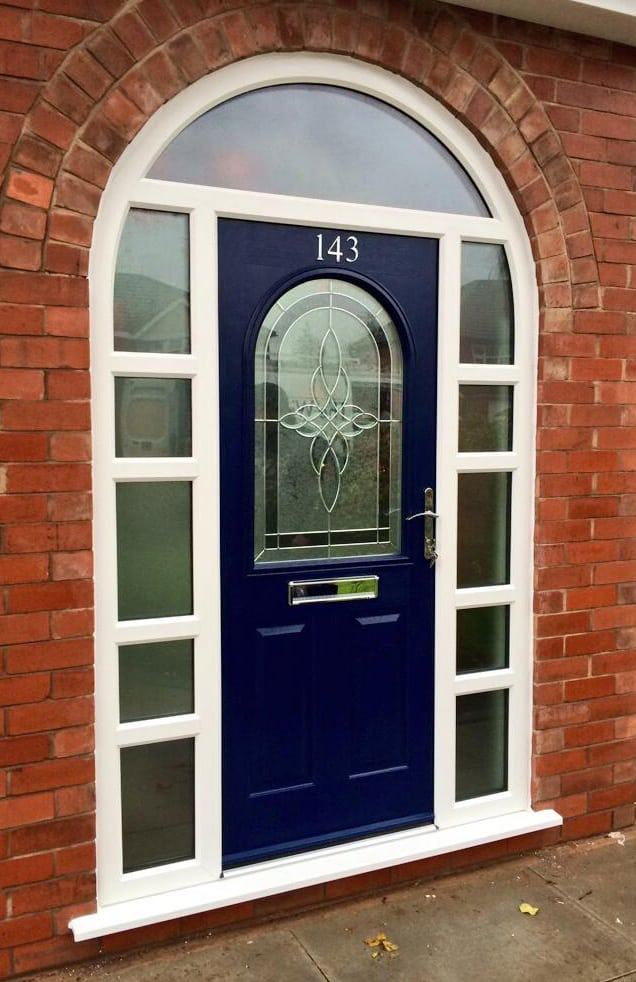 Blue door and arched windows the window company for Window door company