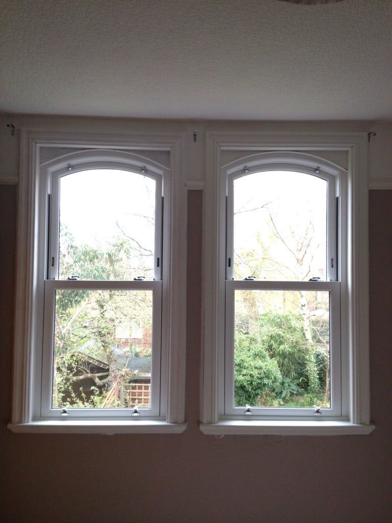 Arched sash upvc windows the window company for Arched bay windows