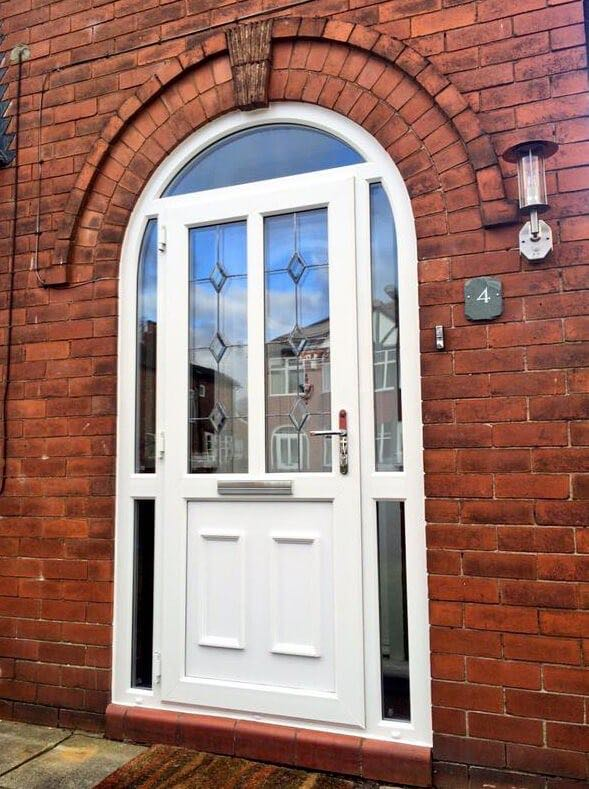 Upvc arched door with diamond bevelled leaded glass the for Arched upvc french doors